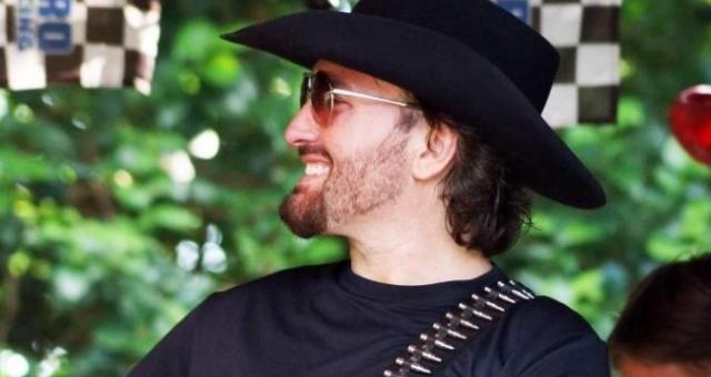 Tom Ben Lindley smiling for photo in cowboy hat